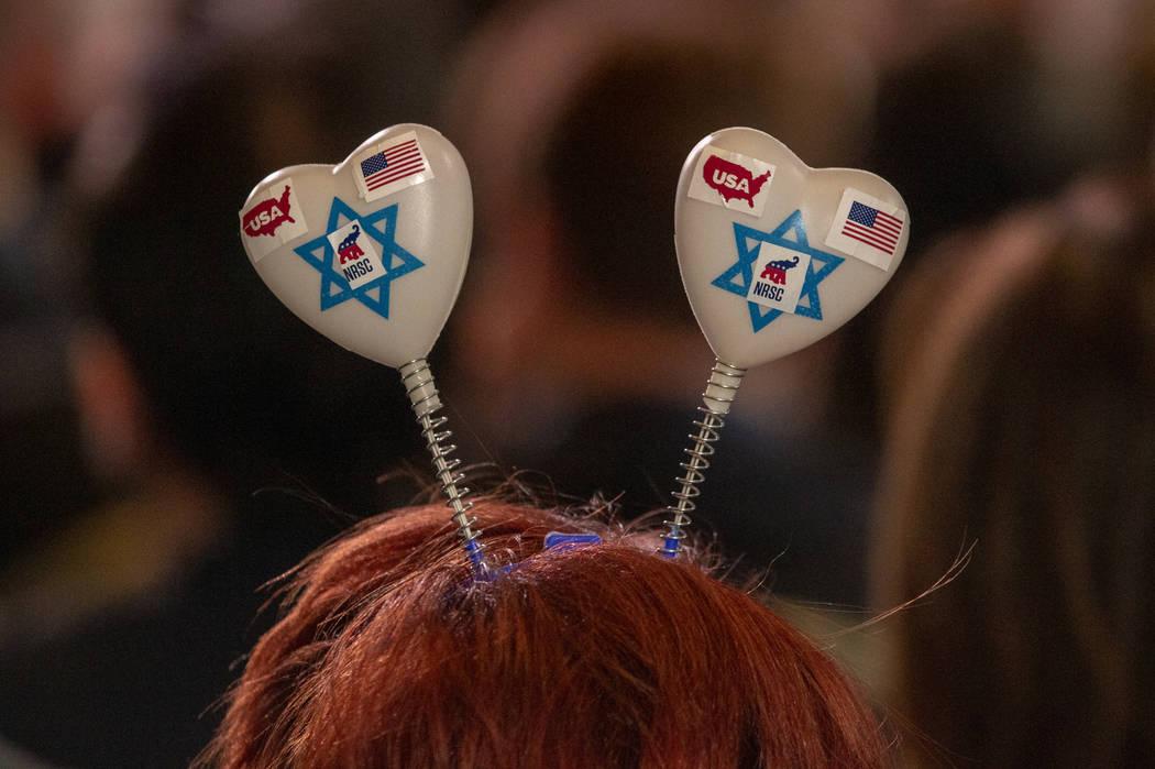 An attendee wears a heart headpiece as President Donald J. Trump addresses the Republican Jewis ...