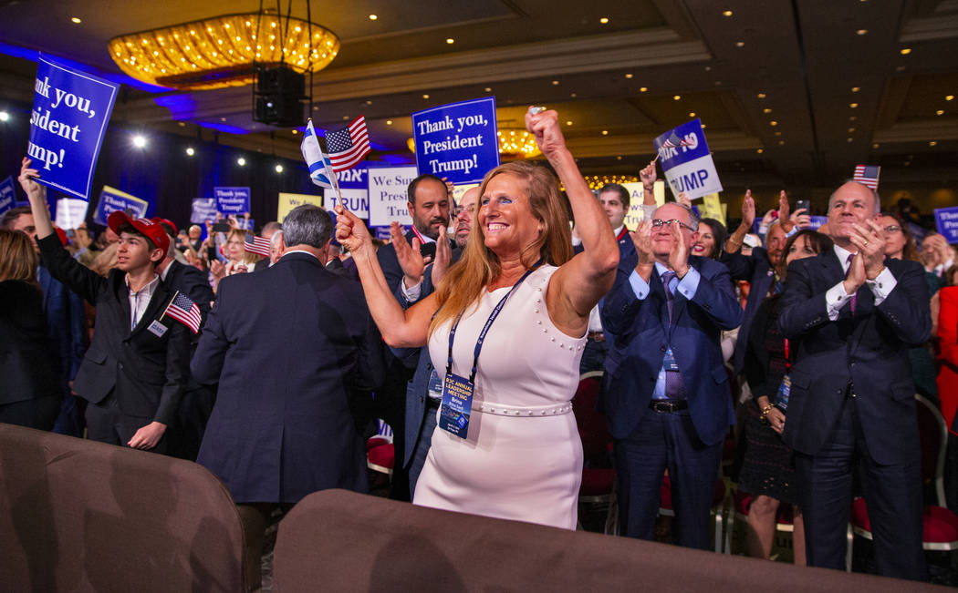 Attendees cheer and applaud as President Donald J. Trump leaves the stage after addressing the ...