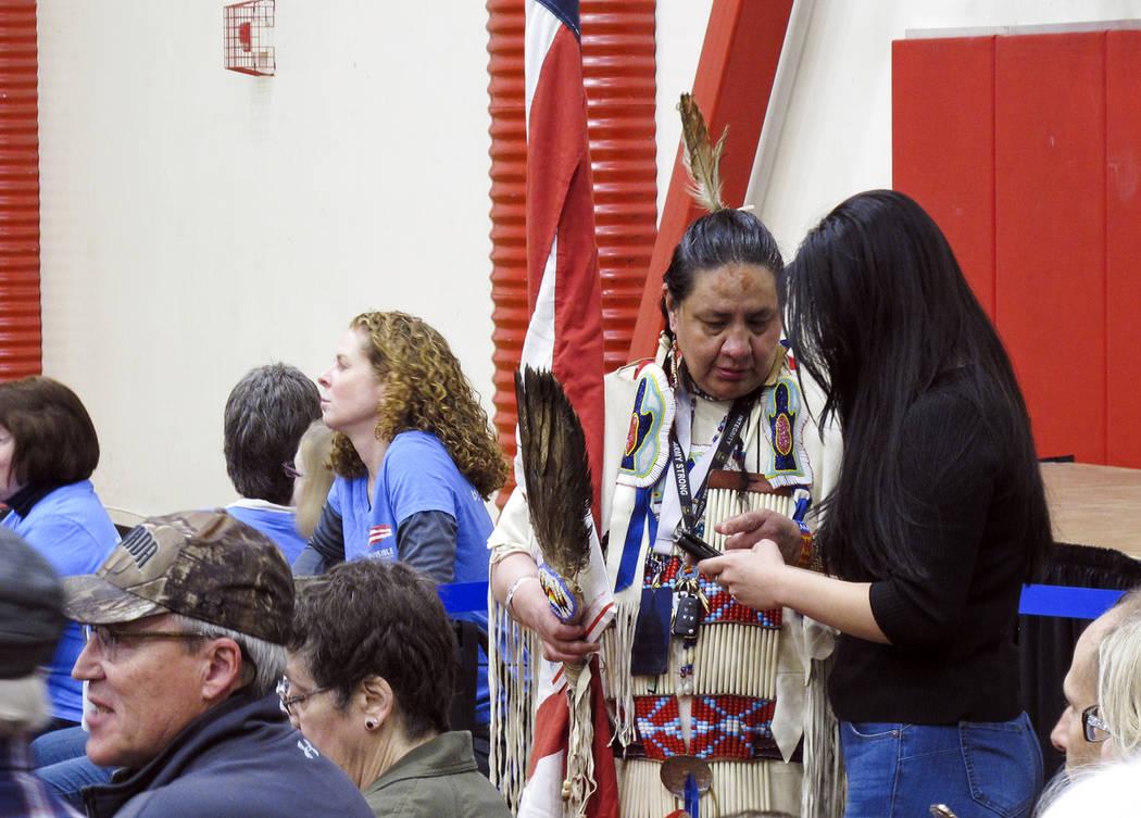 Joann Spotted Bear, a member of the Lakota Tribe, talks to a journalist before Sen. Elizabeth W ...