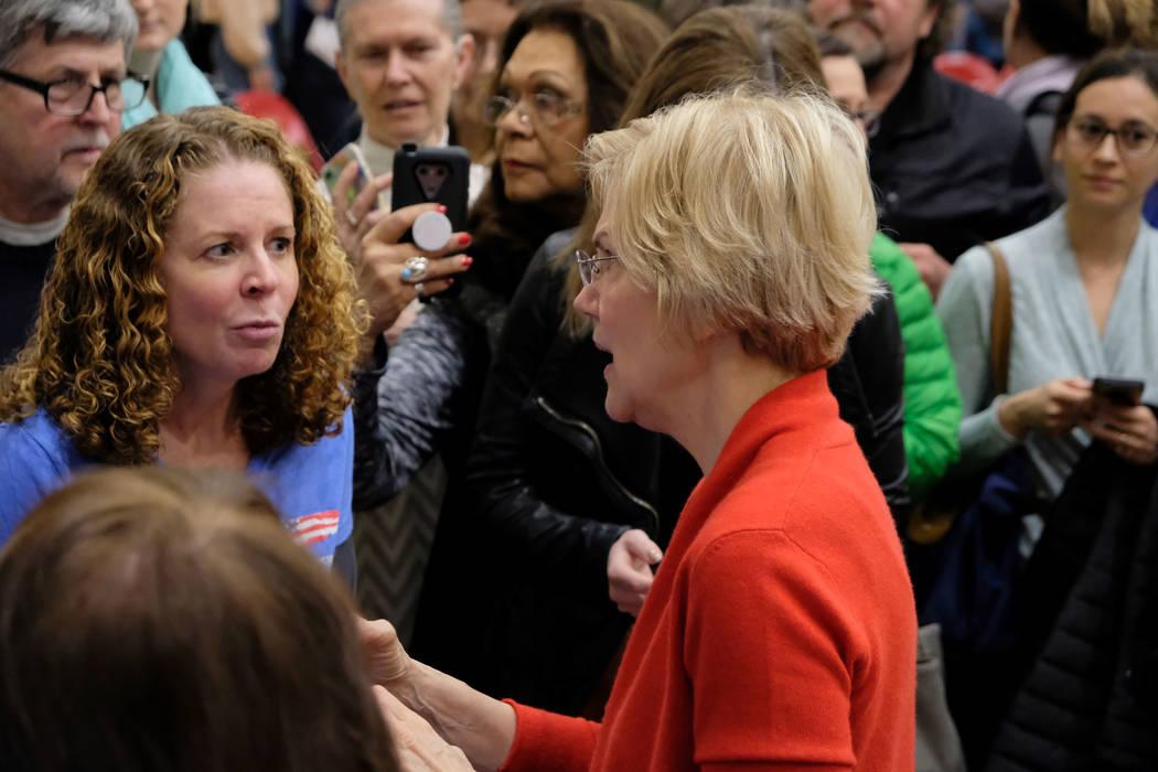 Democratic presidential candidate Sen. Elizabeth Warren, D-Mass., talks to crowd members after ...