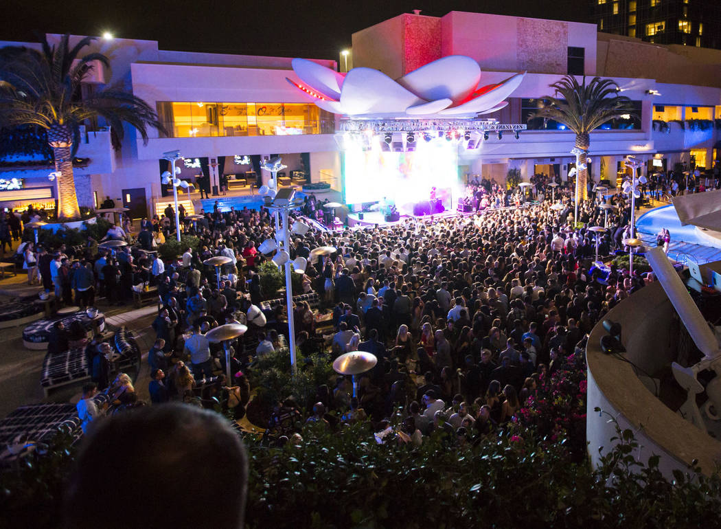Attendees dance to Saint Jhn around the outdoor area the during the grand opening weekend of Ka ...