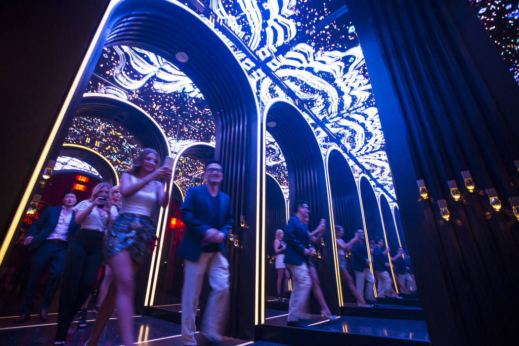 Attendees walk through a mirrored hallway to enter Kaos, the new dayclub and nightclub at the P ...