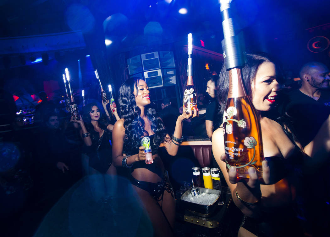 Bottles of champagne are delivered to a table in the nightclub area during the grand opening we ...
