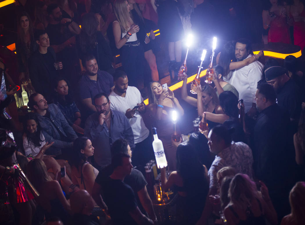 Bottles of alcohol are delivered to a table in the nightclub area during the grand opening week ...