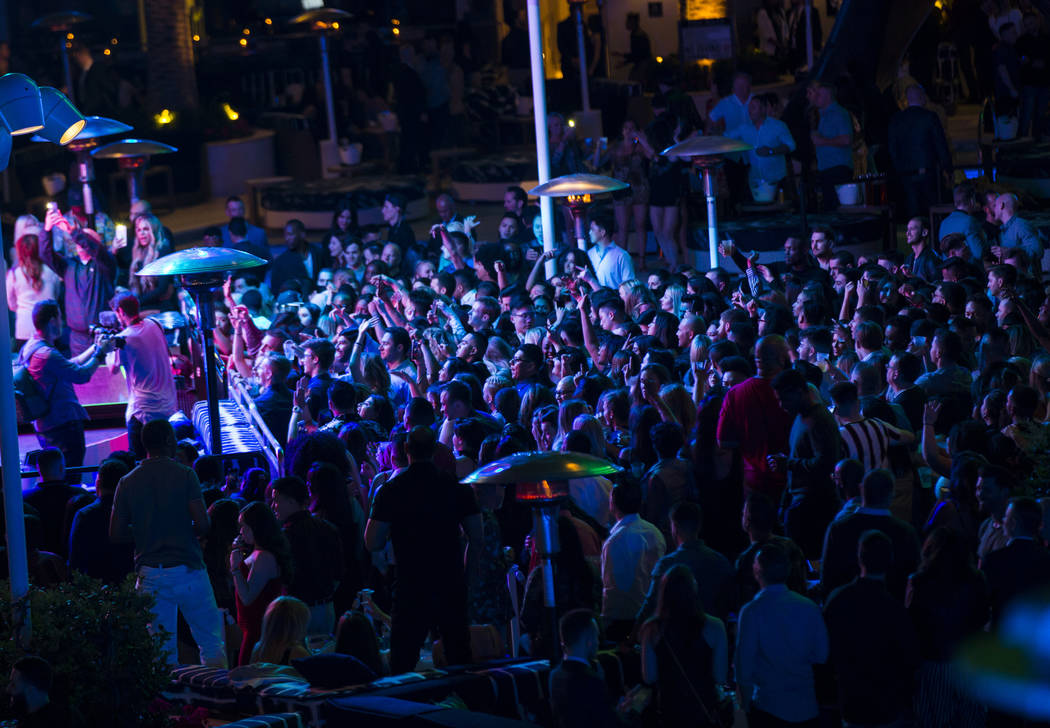 Attendees dance and listen to music during the grand opening weekend of Kaos, the new dayclub a ...