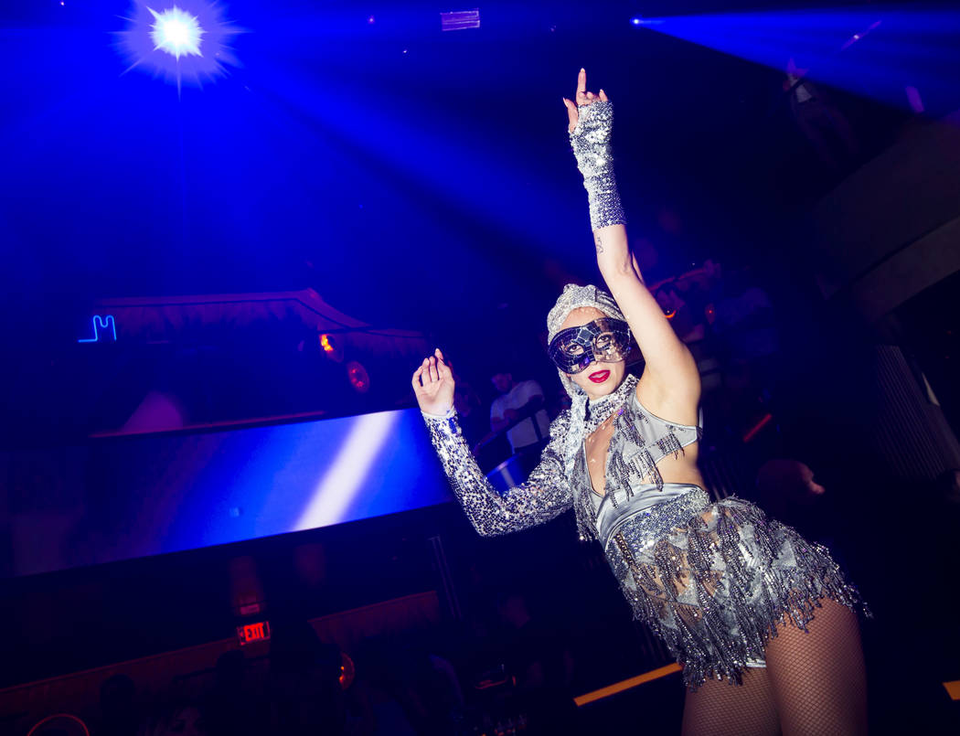 A dancer performs in the nightclub during the grand opening weekend of Kaos, the new dayclub an ...