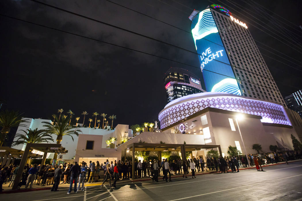Attendees line up outside of the Palms during the grand opening weekend of Kaos, the new dayclu ...