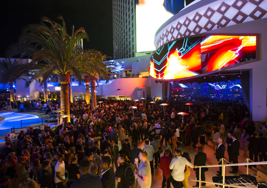 Attendees roam the outdoor area the during the grand opening weekend of Kaos, the new dayclub a ...