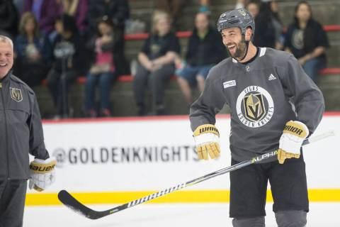 Golden Knights Deryk Engelland shares a laugh with teammates during practice on Wednesday, Oct. ...