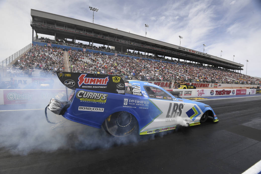 In this photo provided by the NHRA, Tim Wilkerson picks up his first Funny Car No. 1 qualifier ...