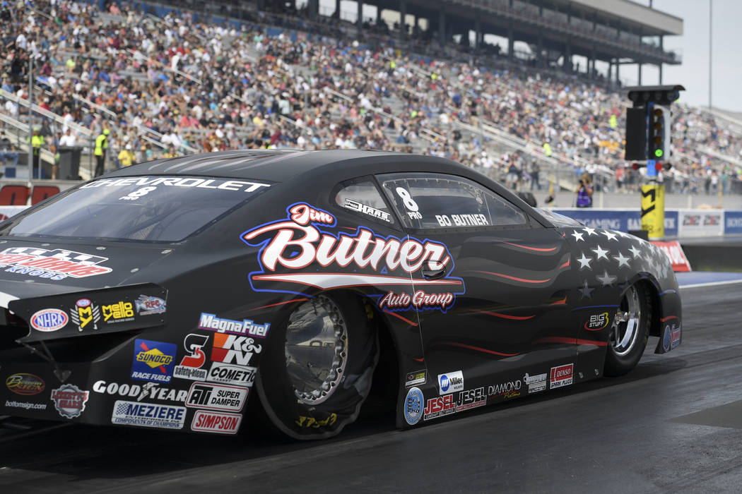 In this photo provided by the NHRA, Bo Butner secures his second No. 1 qualifier of the season ...