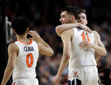 Virginia's Kihei Clark (0), Ty Jerome (11) and Kyle Guy react during the second half in the sem ...