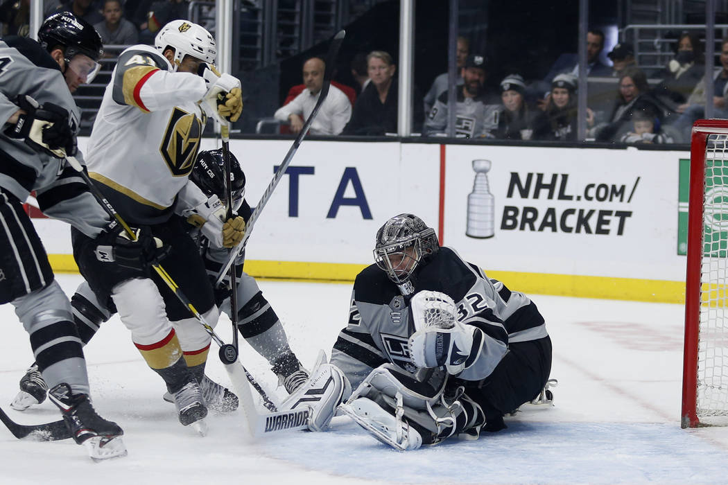 Los Angeles Kings goalie Jonathan Quick (32) stops a shot by Vegas Golden Knights forward Pierr ...