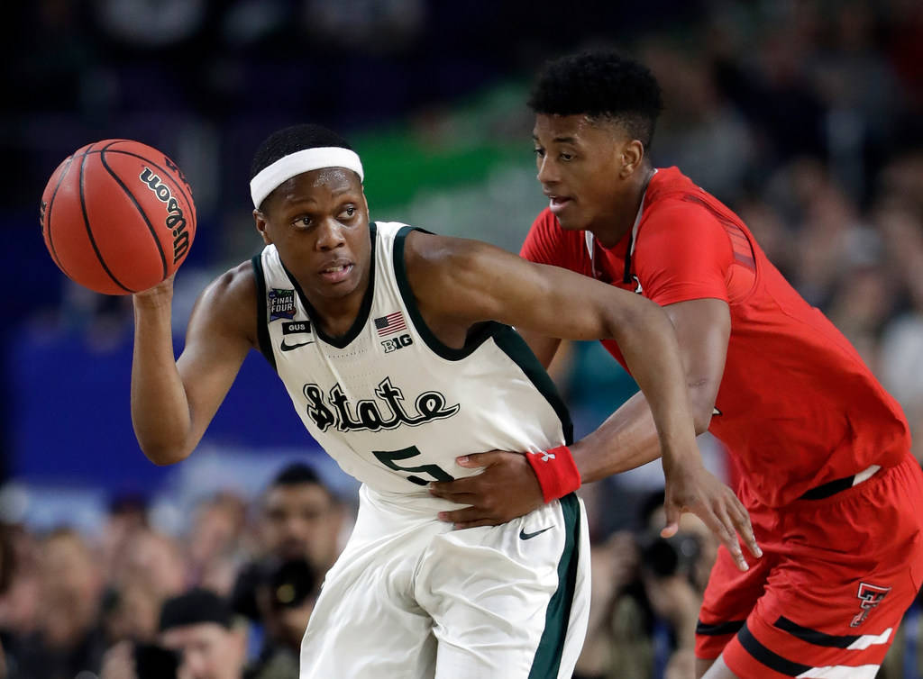 Michigan State's Cassius Winston (5) drives against Texas Tech's Jarrett Culver during the seco ...