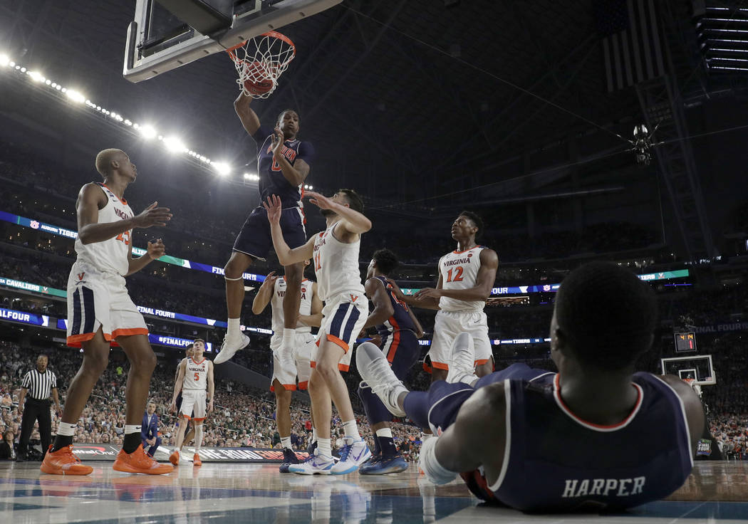 Auburn's Horace Spencer (0) dunks during the first half in the semifinals of the Final Four NCA ...