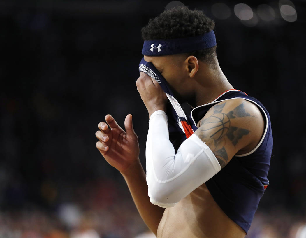 Auburn guard Bryce Brown reacts at the end of a semifinal round game against Virginia in the Fi ...