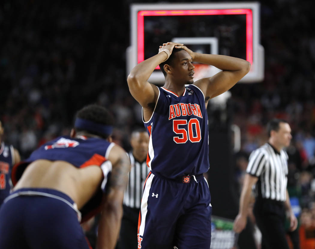 Auburn center Austin Wiley reacts at the end of a semifinal round game against Virginia in the ...