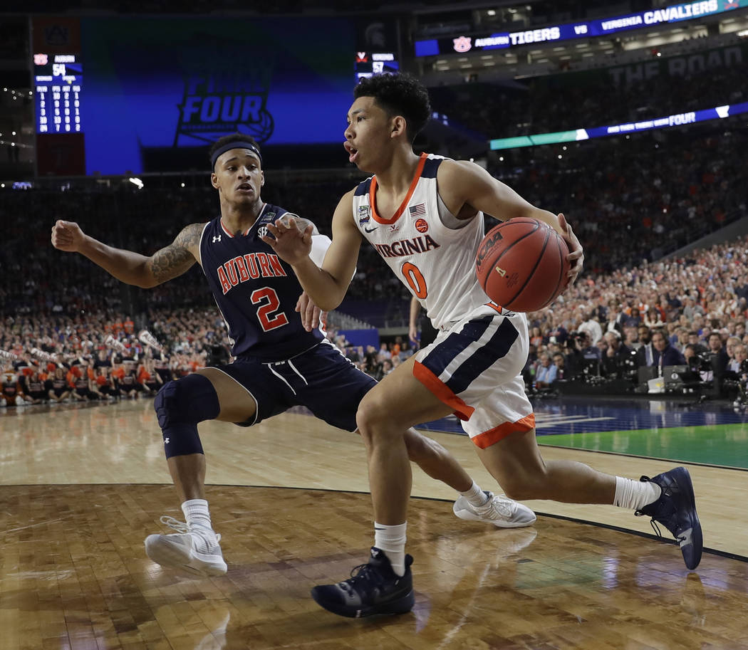 Virginia's Kihei Clark (0) drives against Auburn's Bryce Brown (2) during the second half in th ...