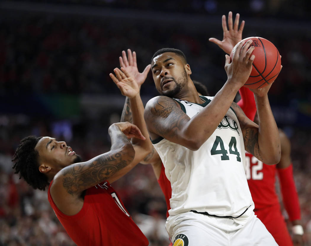 Michigan State's Nick Ward (44) drives against Texas Tech's Kyler Edwards (0) during the second ...