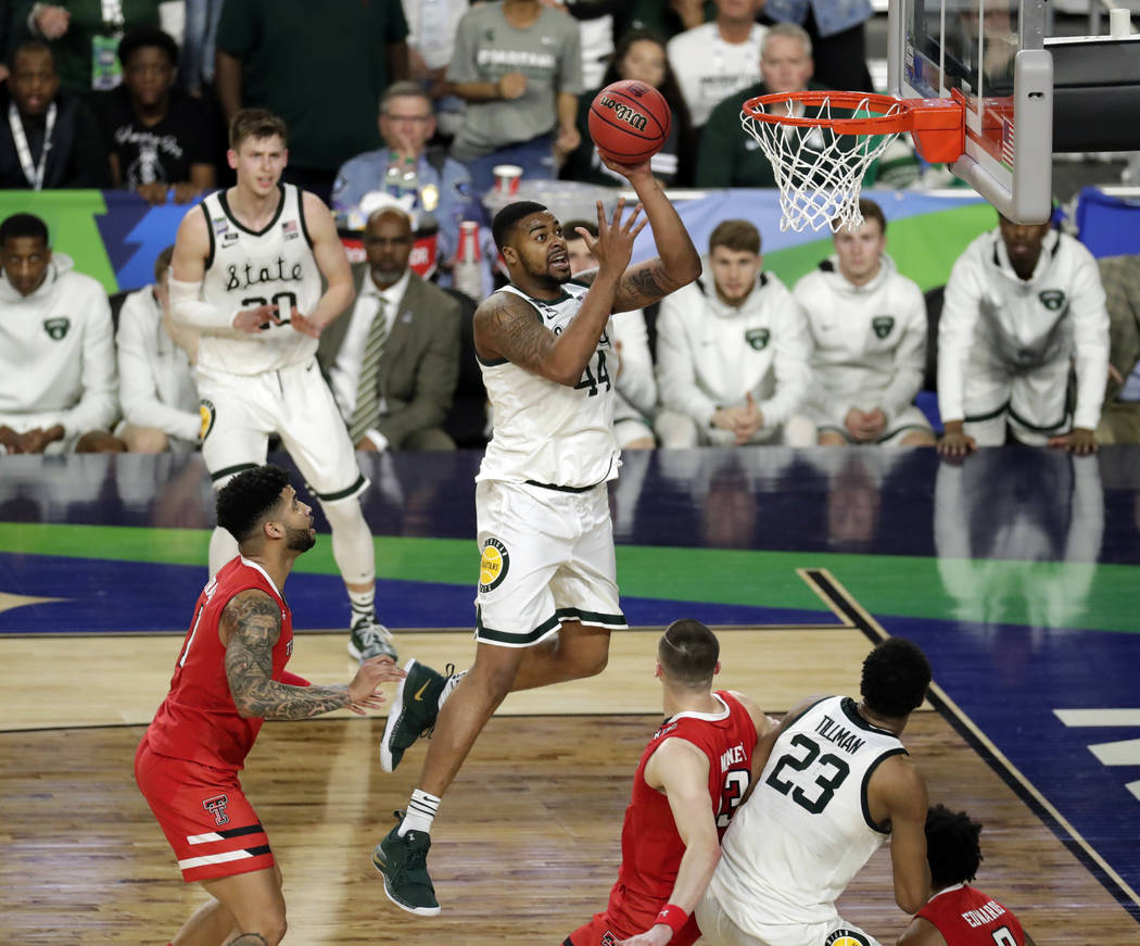 Michigan State's Nick Ward (44) takes a shot during the second half in the semifinals of the Fi ...