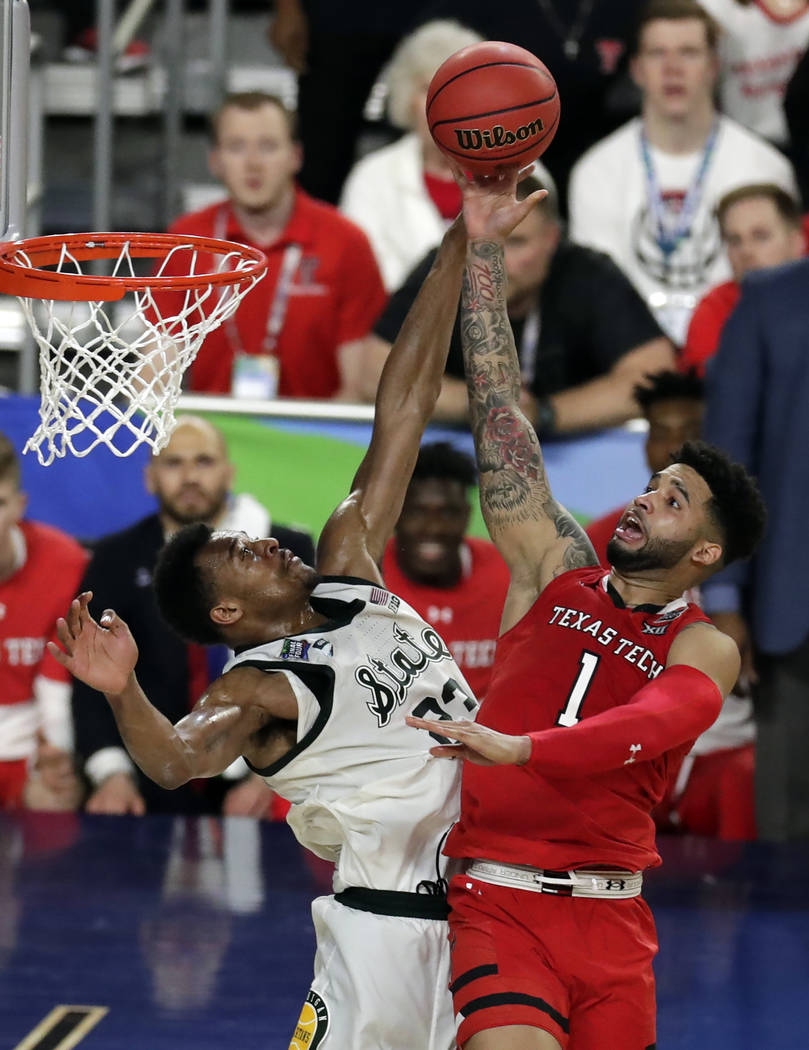 Texas Tech's Brandone Francis (1) shoots over Michigan State's Xavier Tillman (23) during the s ...