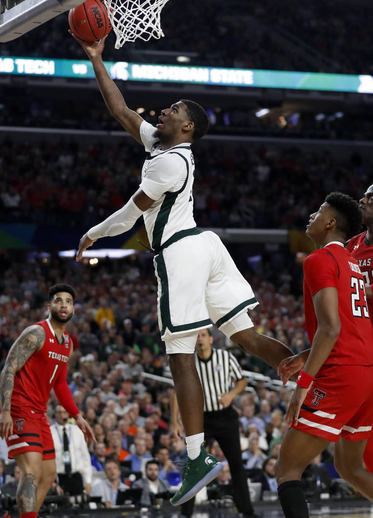 Michigan State's Aaron Henry (11) goes up for a basket during the second half in the semifinals ...