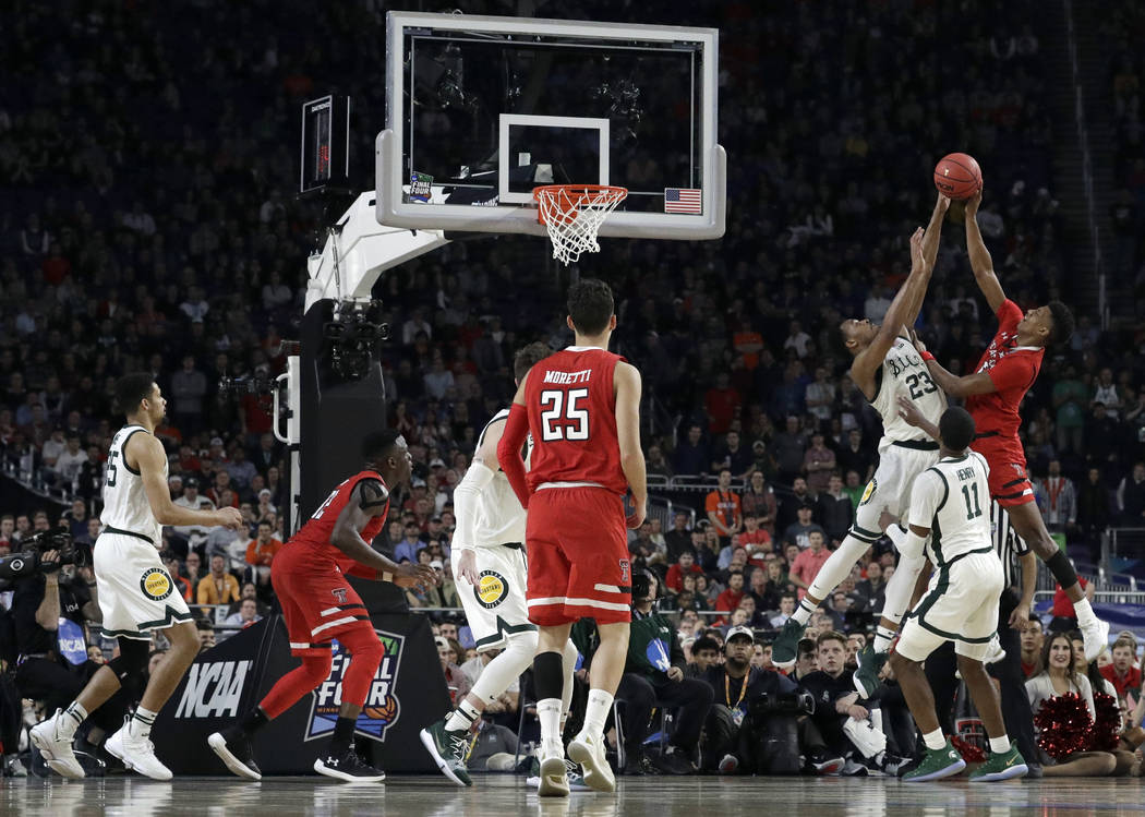 Texas Tech's Jarrett Culver takes a shot against Michigan State's Xavier Tillman (23) during th ...
