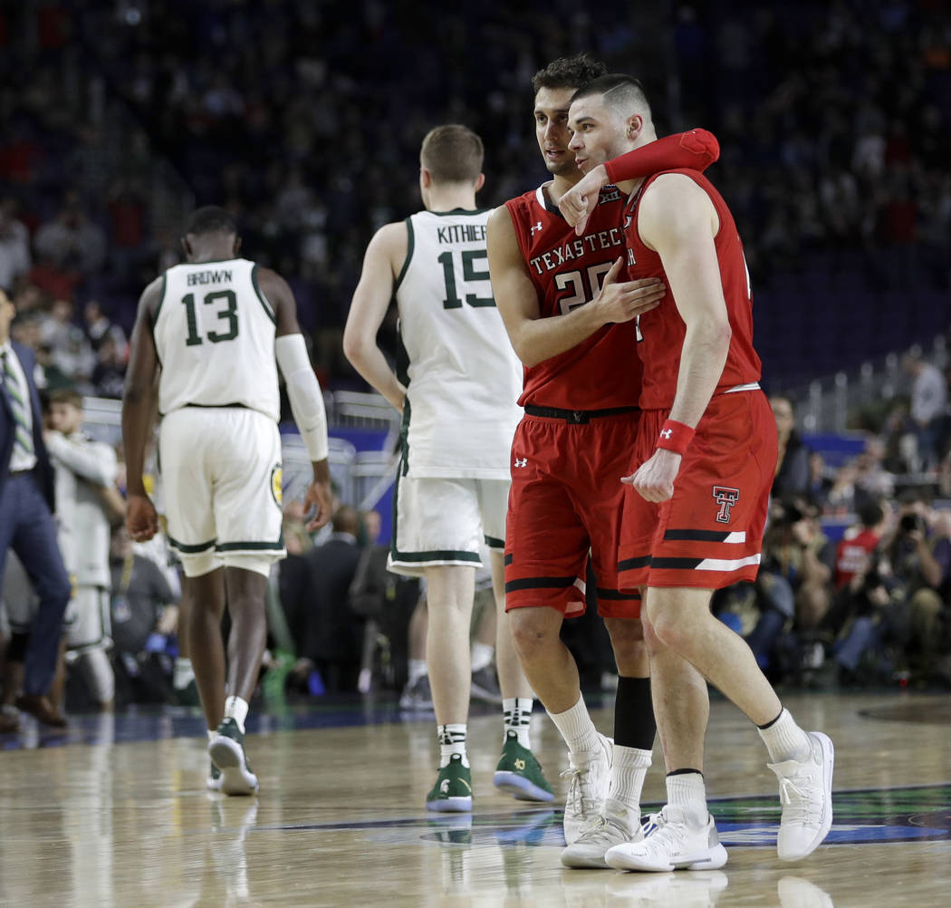 Texas Tech's Davide Moretti (25) and Matt Mooney celebrate after defeating Michigan State 61-51 ...