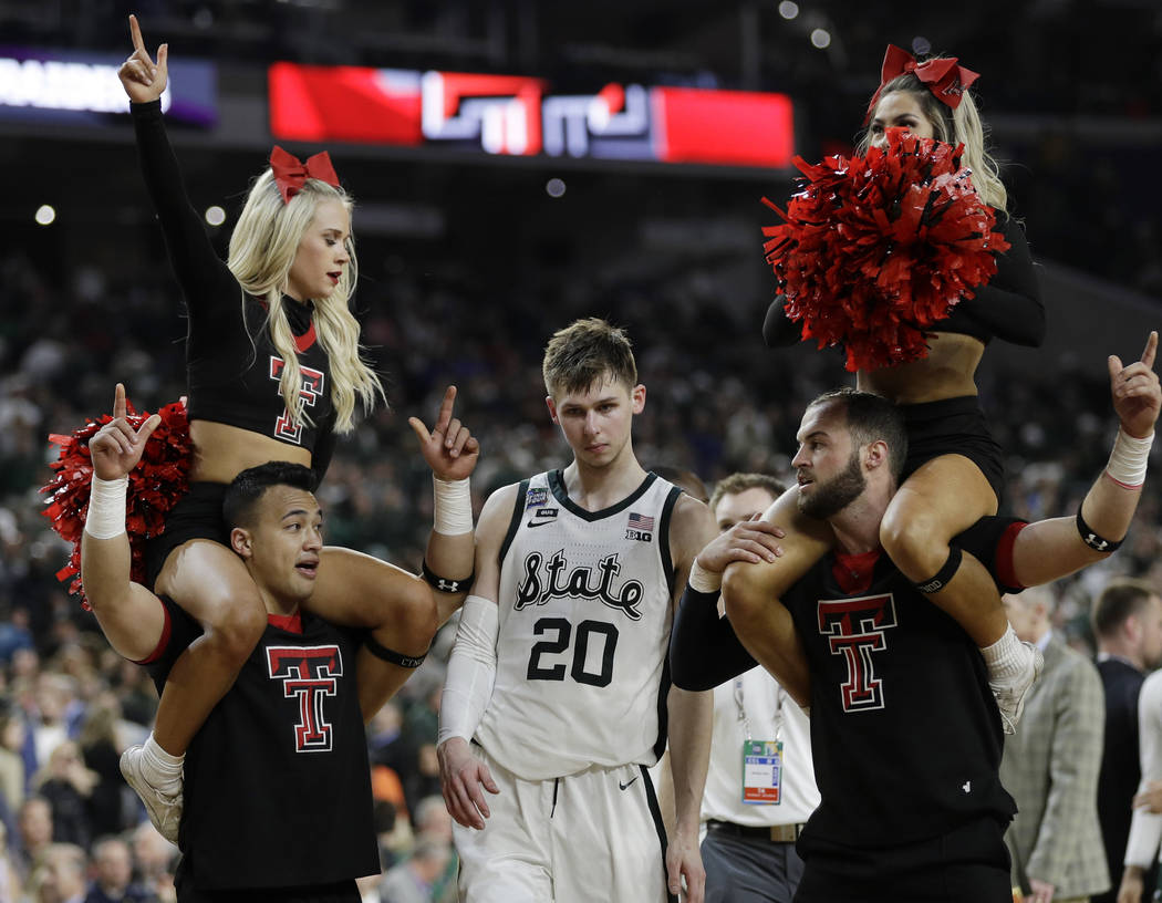 Michigan State's Matt McQuaid (20) leaves the court after the team's 61-51 loss to Texas Tech i ...
