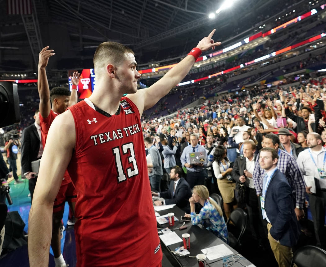 Texas Tech guard Matt Mooney reacts to fans after a semifinal round game against Michigan State ...
