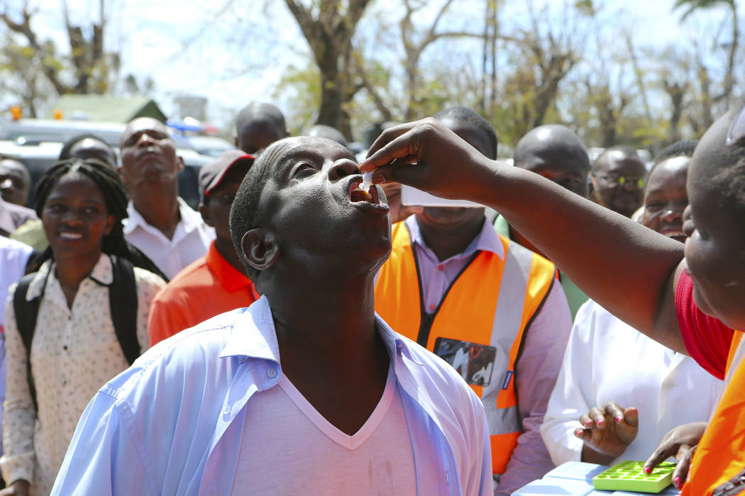 The Mayor of Beira, Daviz Simango receives an oral cholera vaccination at a camp for displaced ...