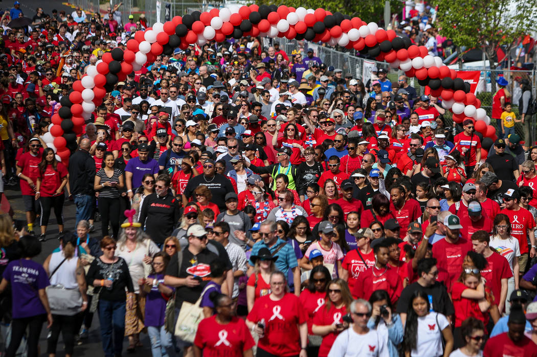 People participate in the 29th Annual AIDS Walk Las Vegas at Town Square in Las Vegas, Sunday, ...