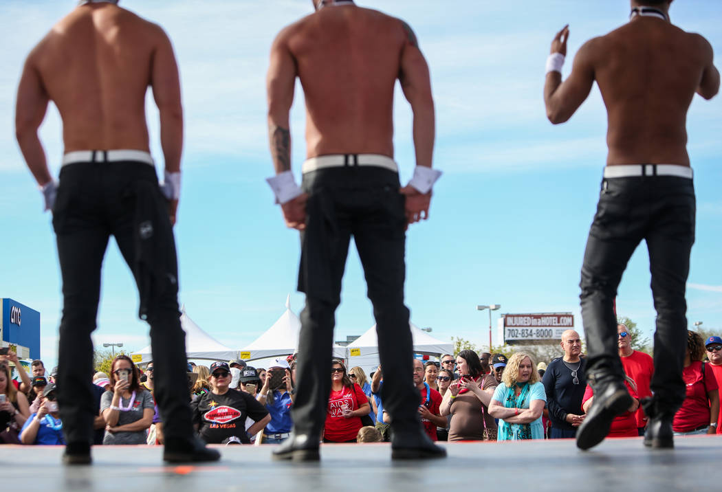 Chippendales performers talk on stage at the 29th Annual AIDS Walk Las Vegas at Town Square in ...