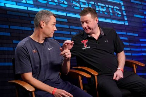 Virginia head coach Tony Bennett, left, and Texas Tech head coach Chris Beard talk after an int ...