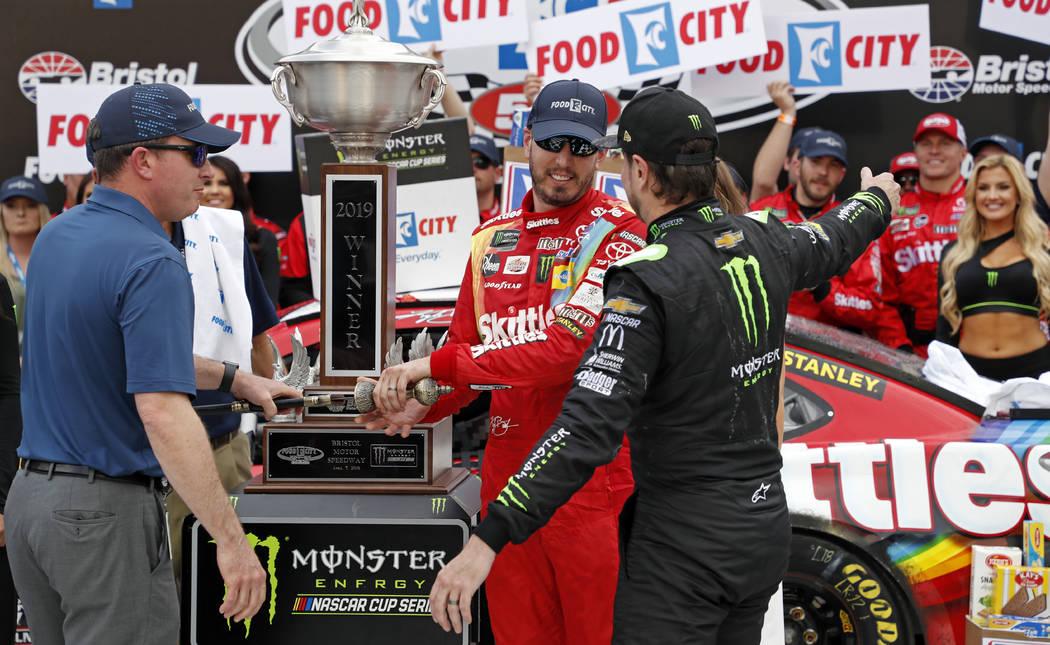 Kyle Busch gets a hug from brother Kurt Busch, right, after winning the NASCAR Cup Series auto ...