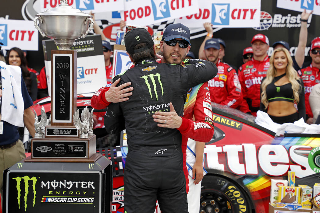 Kyle Busch, facing camera, gets a hug from brother Kurt Busch after winning the NASCAR Cup Seri ...