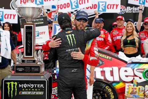 Kyle Busch, facing camera, gets a hug from brother Kurt Busch after winning the NASCAR Cup Seri ...