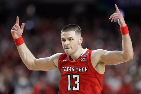Texas Tech guard Matt Mooney celebrates after making a three-point basket during the second hal ...