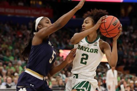Baylor guard DiDi Richards (2) looks to pass the ball as Notre Dame guard Jackie Young (5) defe ...