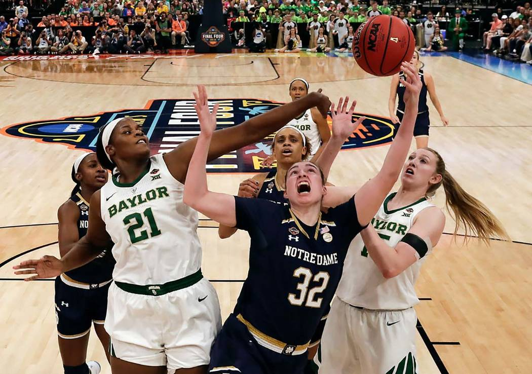 Baylor's Kalani Brown (21) blocks a shot attempt by Notre Dame's Jessica Shepard (32) during th ...