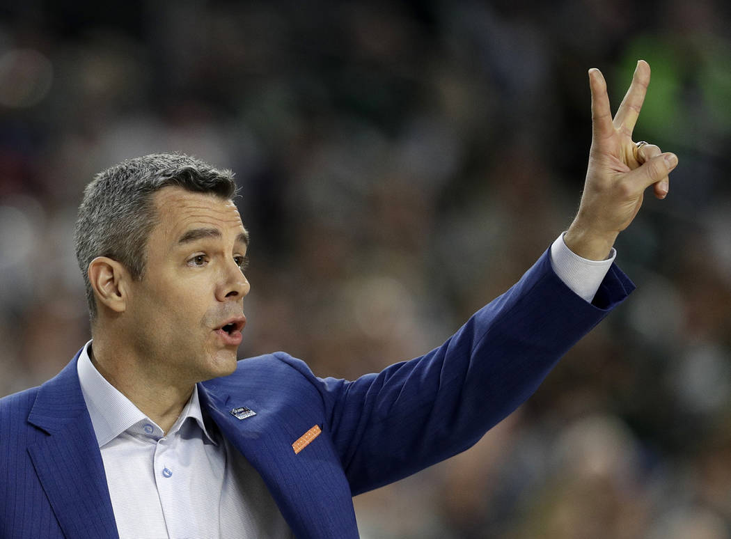 Virginia head coach Tony Bennett directs his team during the first half in the semifinals of th ...