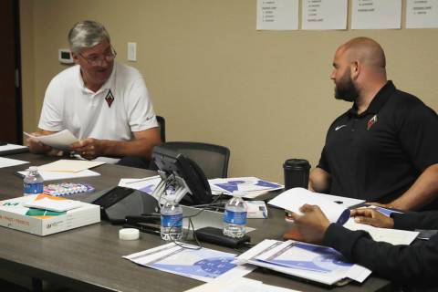 Aces general manager Dan Padover (middle) meets with head coach Bill Laimbeer and assistant coa ...