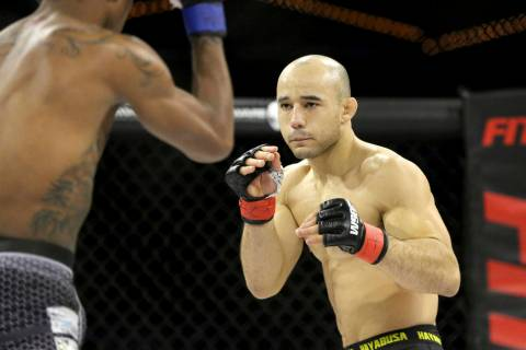 Marlon Moraes in action against Josinaldo Silva during their WSOF bantamweight title fight at t ...