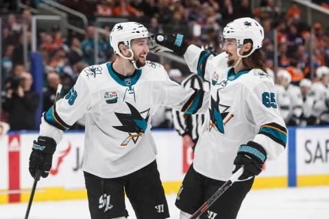San Jose Sharks' Melker Karlsson (68) and Erik Karlsson (65), celebrate a goal against the Edmo ...