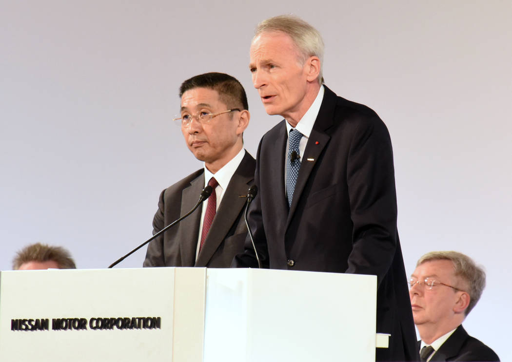 In this photo released by Nissan Motor Co., Renault Chairman Jean-Dominique Senard, center righ ...