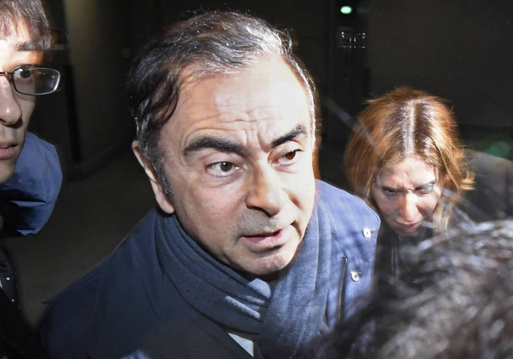 FILE - In this April 3, 2019, file photo, former Nissan Chairman Carlos Ghosn, center, leaves h ...