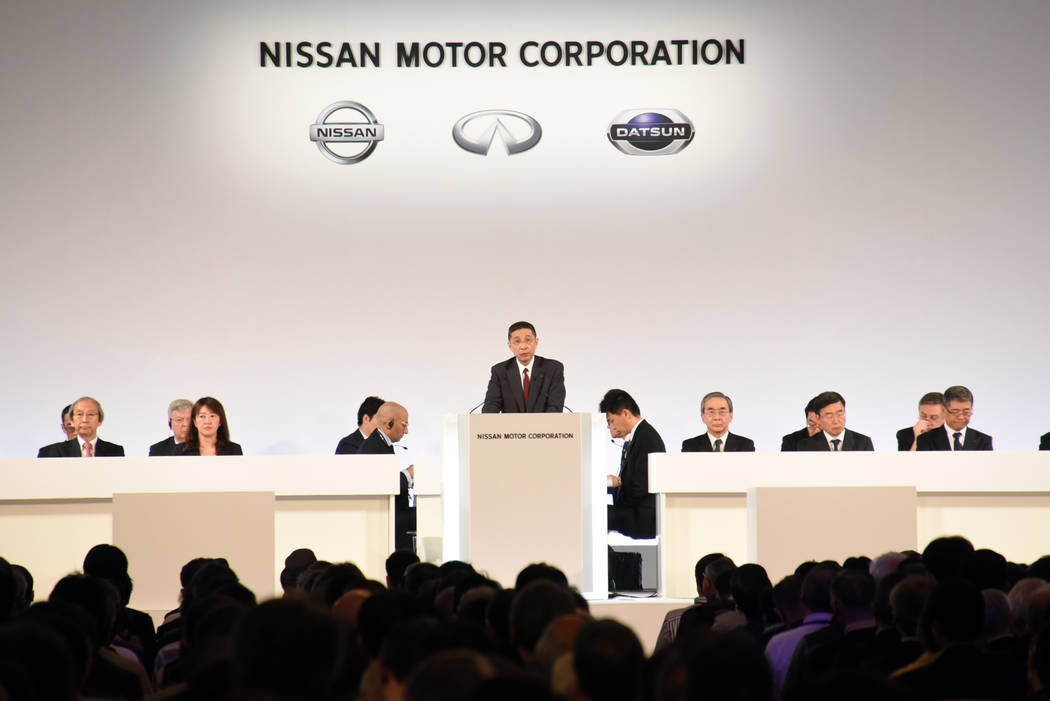Nissan Chief Executive Hiroto Saikawa, center, speaks at the company's shareholders' meeting in ...