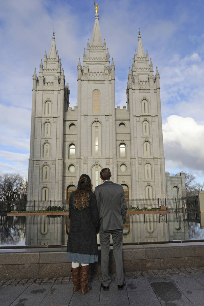 A couple looks at the Salt Lake City temple during the The Church of Jesus Christ of Latter-day ...