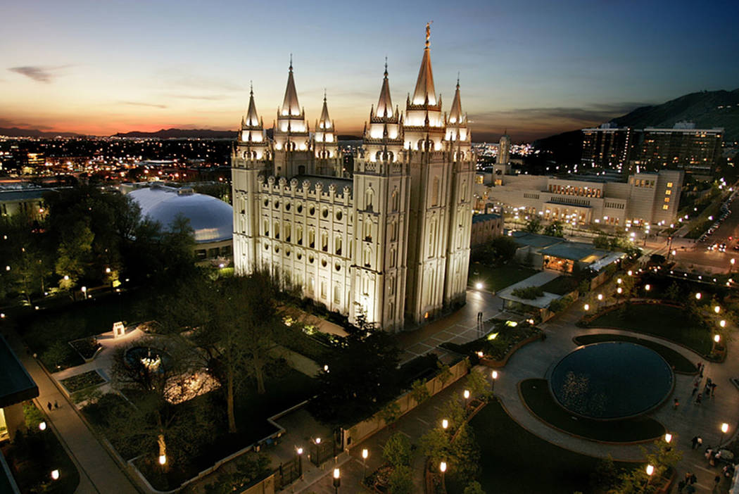 The sun sets behind the Mormon Temple, the centerpiece of Temple Square, in Salt Lake City in 2 ...