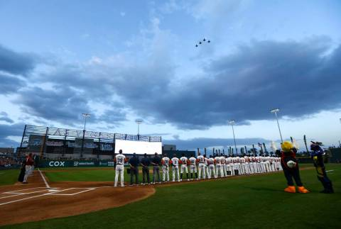 Nellis Air Force Base pilots fly over the field before the start of the Las Vegas Aviators' hom ...